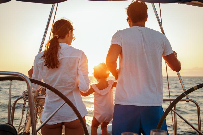 family with baby girl enjoying sailing